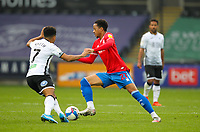 20th April 2021; Liberty Stadium, Swansea, Glamorgan, Wales; English Football League Championship Football, Swansea City versus Queens Park Rangers; Chris Willock of Queens Park Rangers goes past Korey Smith of Swansea City