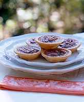 Miniature pecan pies are served to guests at this autumn themed dinner party