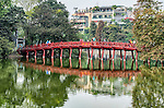 The Huc Bridge is a red wooden bridge which extends from the shore of Hoan Kiem Lake to the Temple of the Jade Mountain, located on a small island in the lake. The lake is located in the old quarter of Hanoi and is a central feature of the city.