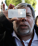 Apple co-founder Steve Wozniak holds up his new Apple iPhone 4S at the Apple store in Los Gatos, Calif., Friday, Oct. 14, 2011. Wozniak waited 20 hours in line to be the first Apple customer at the Los Gatos Apple store to buy the new iPhone. (AP Photo/Paul Sakuma)