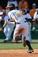Josh Liles #33 of the Tennessee Volunteers runs down the first baseline at Lindsey Nelson Stadium against the the Manhattan Jaspers on March 12, 2011 in Knoxville, Tennessee.  Tennessee won the first game of the double header 11-5.  Photo by Tony Farlow / Four Seam Images..