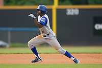 Derrick Robinson #11 of the Wilmington Blue Rocks takes off for third base at Wake Forest Baseball Stadium June 14, 2009 in Winston-Salem, North Carolina. (Photo by Brian Westerholt / Four Seam Images)