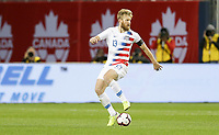TORONTO, ON - OCTOBER 15: Tim Ream #13 of the United States moves with the ball during a game between Canada and USMNT at BMO Field on October 15, 2019 in Toronto, Canada.