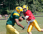 Waterbury, CT-28 August 2012-082812CM14-    Holy Cross'  Adrian Brown (left), receives a handoff from quarterback Kristian Harmeling, during practice Tuesday afternoon in Waterbury.   Christopher Massa Republican-American