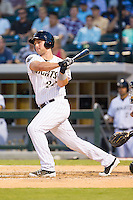 Matt Davidson (22) of the Charlotte Knights follows through on his swing against the Louisville Bats at BB&T Ballpark on June 26, 2014 in Charlotte, North Carolina.  The Bats defeated the Knights 6-4.  (Brian Westerholt/Four Seam Images)