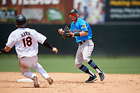 Akron RubberDucks shortstop Alexis Pantoja (1) turns a double play as Austin Hays (18) slides in during an Eastern League game against the Bowie Baysox on May 30, 2019 at Prince George's Stadium in Bowie, Maryland.  Akron defeated Bowie 9-5.  (Mike Janes/Four Seam Images)