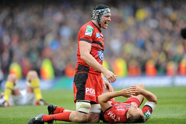Nick Kennedy (left) congratulates Jonny Wilkinson of RC Toulon after he collapses in delight at the final whistle of the Heineken Cup Final between ASM Clermont Auvergne and RC Toulon at the Aviva Stadium, Dublin on Saturday 18th May 2013 (Photo by Rob Munro)
