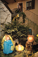 """Switzerland. Canton Tessin. Vira Gambarogno. The old town shows an exhibit of various Nativity scenes, illuminated at night for the Christmas holiday season. A Nativity Scene, may be used to describe any depiction of the Nativity of Jesus in art, but in the sense covered here, also called a crib or in North America and France a crèche (meaning """"crib"""" or """"manger"""" in French). It means a three-dimensional folk art depiction of the birth or birthplace of Jesus, either sculpted or using two-dimensional (cut-out) figures arranged in a three-dimensional setting. Christian nativity scenes, in two dimensions (drawings, paintings, icons, etc.) or three (sculpture or other three-dimensional crafts), usually show Jesus in a manger, Joseph and Mary in a barn (or cave) intended to accommodate farm animals. The Star of Bethlehem. Fir. © 2007 Didier Ruef"""