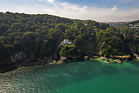 BNPS.co.uk (01202 558833)<br /> Pic: Savills/BNPS<br /> <br /> The property boasts 180 degree views of some of the most spectacular scenery the UK has to offer. <br /> <br /> A breathtaking clifftop home that comes with its own private beach has emerged for sale for an incredible £2m.<br /> <br /> Bar Lodge, which dates back to the Edwardian period, sits in a stunning coastal position right in the mouth of the Salcombe Estuary in Devon.<br /> <br /> It is positioned high above the sea and enjoys unrivaled views right across the picturesque waterway and rocky coastline.