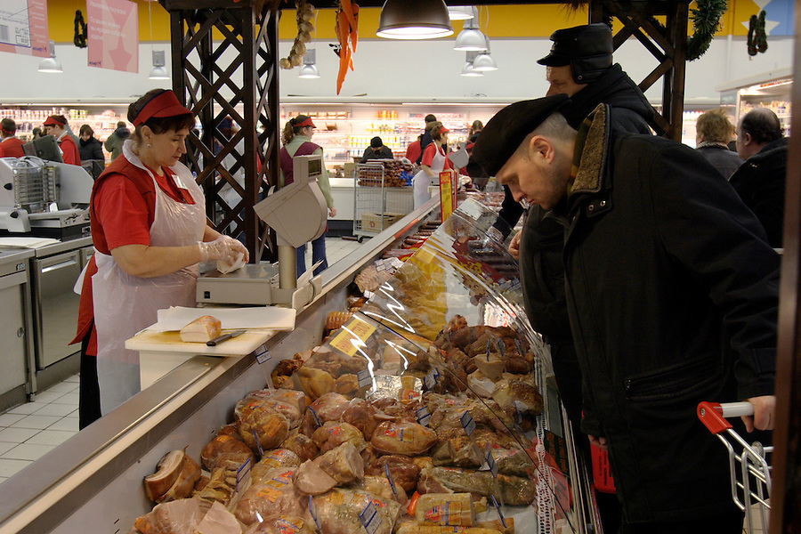 Moscow, Russia, 03/01/2004..Customers in the fresh meat section at the Mosmart shopping mall.