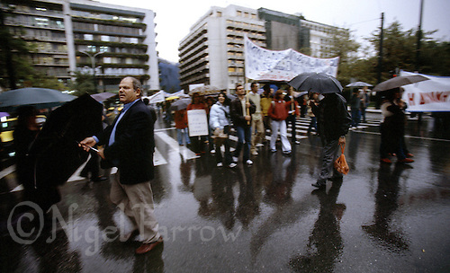 """04 NOV 2003 - ATHENS, GREECE - """"What are they striking about ?"""" I asked. """"What day is it ?"""" replied the shopkeeper. Athenians ignore yet another strike as they go about their business. (PHOTO (C) NIGEL FARROW)"""