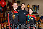 Roisin Quinn and Anna Buckley standing with Aidan Mahoney at the Cillard Camogie Medal presentation in Kate Browns in Ardfert on Friday night.