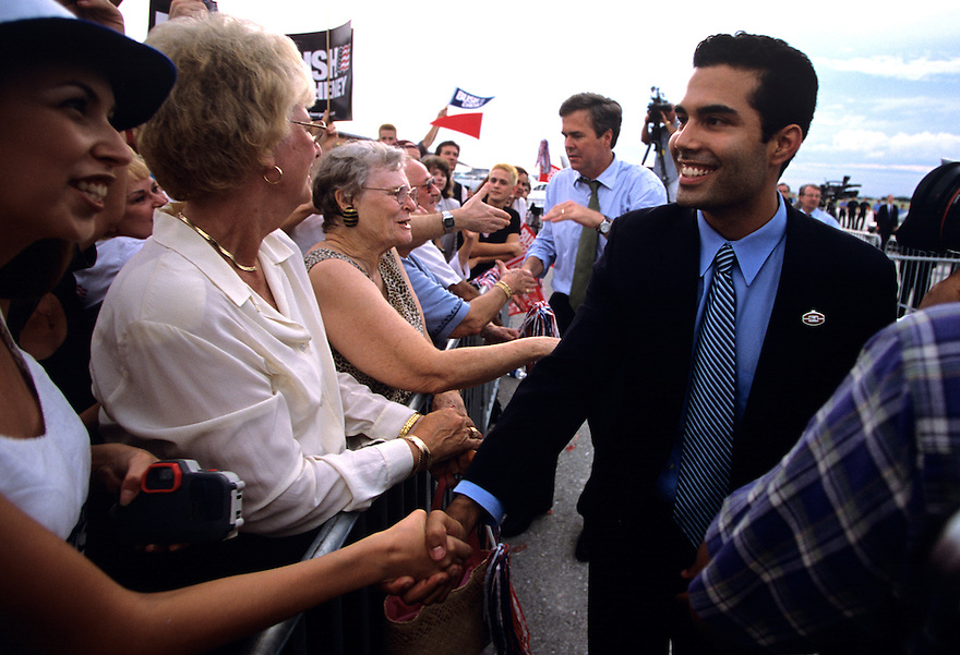 Florida Governor Jeb Bush and son George P. Bush (foreground) shake hands on while campaigning for George W. Bush during his bid for the White House.