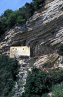 Old stone building on side of mountain<br />