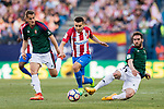 Fausto Tienza Nunez of Osasuna  (R) trips up with Angel Correa of Atletico de Madrid (C) during the La Liga match between Atletico de Madrid vs Osasuna at the Estadio Vicente Calderon on 15 April 2017 in Madrid, Spain. Photo by Diego Gonzalez Souto / Power Sport Images