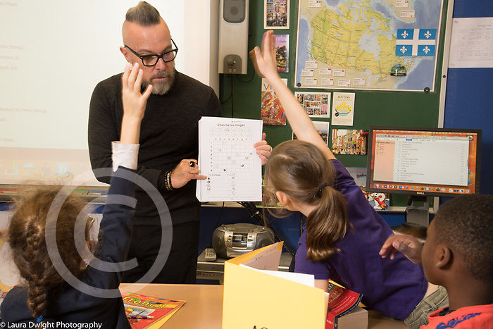 Public elementary school for gifted children grades K-6: foreign language class taught by man