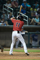 Craig Dedelow (11) of the Birmingham Barons at bat against the Mississippi Braves at Regions Field on August 3, 2021, in Birmingham, Alabama. (Brian Westerholt/Four Seam Images)