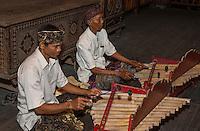 Jimbaran, Bali, Indonesia.  Two Men Playing Balinese Bamboo  Xylophones.
