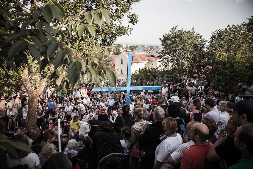 Crowd of faithful at the Blue Cross shrine moments before the apparition to the visionary Mirjana <br /> Bijakovici, Medjugorje, Bosnia and Herzegovina. 02 July 2012