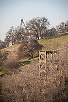 Historic iron headframe of the Fremont gold,mine and the concrete gallows headframe of the Treasure Hill gold mine, Amador County, Calif.