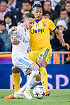 Lucas Vazquez of Real Madrid (L) fights for the ball with Alex Sandro of Juventus (R) during the UEFA Champions League 2017-18 quarter-finals (2nd leg) match between Real Madrid and Juventus at Estadio Santiago Bernabeu on 11 April 2018 in Madrid, Spain. Photo by Diego Souto / Power Sport Images