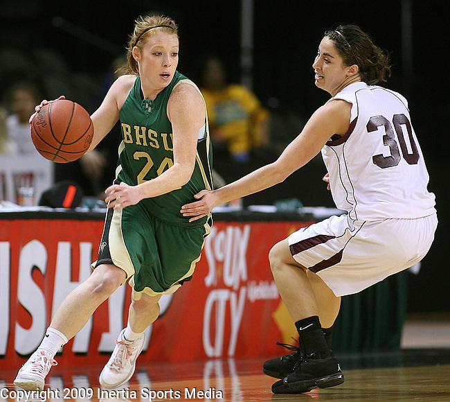 SIOUX CITY, IA - MARCH 14, 2009 --  Katelynn Lamb #24 of Black Hills State drives around Leslie Foral #30 of Morningside College during their 2009 NAIA DII Women's Basketball National Championship quarterfinal game Saturday at the Tyson Events Center in Sioux City. (Photo by Dick Carlson/Inertia)