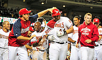28 September 2010: Washington Nationals' first baseman Adam Dunn is surrounded and congratulated by teammates after hitting a walk-off solo home run in the bottom of the 9th inning against the Philadelphia Phillies at Nationals Park in Washington, DC. The Nationals defeated the Phillies 2-1 to even up their 3-game series one game apiece. Mandatory Credit: Ed Wolfstein Photo