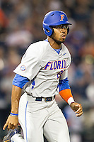 Florida Gators outfielder Buddy Reed (23) runs to first base during the NCAA College baseball World Series against the Virginia Cavaliers on June 15, 2015 at TD Ameritrade Park in Omaha, Nebraska. Virginia defeated Florida 1-0. (Andrew Woolley/Four Seam Images)