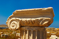 Delphic coloumn capitals of the ruins of the Greek city of Delos, the birthplace of the twin gods Apollo and Artemis. Greek Cyclades Islands.