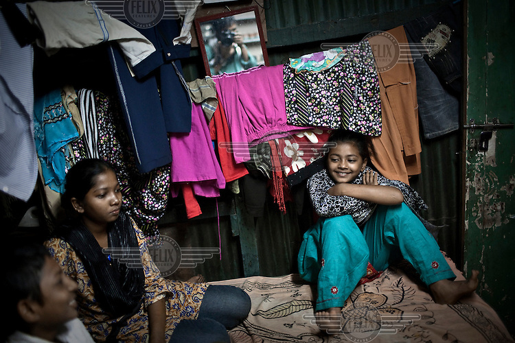 12 year old Rubina Ali (right), a child actor who starred in the film Slumdog Millionaire, poses for a portrait in the Garib Nagar slum in North Mumbai with her family. Two years after the film was made, Rubina and her family still live in the slum due to a dispute over the money offered by the film's producers for her family to buy a new home.
