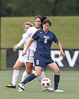 Yale University forward Anne Song (6) attempts to control the ball as Harvard University midfielder Aisha Price (5) pressures. In overtime, Harvard University defeated Yale University,1-0, at Soldiers Field Soccer Stadium, on September 29, 2012.