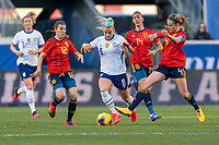 HARRISON, NJ - MARCH 08: Patricia Guijarro #12 and Irene Paredes #4 of Spain try to defend Julie Ertz #8 of the United States during a game between Spain and USWNT at Red Bull Arena on March 08, 2020 in Harrison, New Jersey.