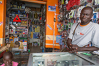 Senegal, Saint Louis.  Shopkeeper Selling Auto Spare Parts at Bus and Taxi Station.