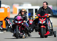 Oct. 29, 2011; Las Vegas, NV, USA: NHRA pro stock motorcycle rider Angie Smith (left) with a crew member during qualifying for the Big O Tires Nationals at The Strip at Las Vegas Motor Speedway. Mandatory Credit: Mark J. Rebilas-