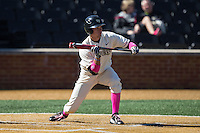 Bruce Steel (17) of the Wake Forest Demon Deacons squares to bunt against the Virginia Tech Hokies at Wake Forest Baseball Park on March 7, 2015 in Winston-Salem, North Carolina.  The Hokies defeated the Demon Deacons 12-7 in game one of a double-header.   (Brian Westerholt/Four Seam Images)