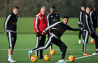 Pictured: Caretaker manager Alan Curtis (C) surrounded by players Franck Tabanou, Ashley Williams and Neil Taylor Wednesday 23 December 2015<br />Re: Swansea City FC training ahead of their West Bromwich Albion game, Fairwood, near Swansea, Wales, UK