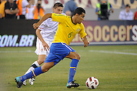 Andre Santos (6) of Brazil is marked by Alejandro Bedoya (11) of the United States. The men's national team of Brazil (BRA) defeated the United States (USA) 2-0 during an international friendly at the New Meadowlands Stadium in East Rutherford, NJ, on August 10, 2010.