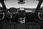 Stock photo of straight dashboard view of a 2018 BMW 1 Series Base 5 Door Hatchback