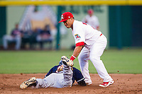 Kolten Wong (4) of the Springfield Cardinals tries to apply a tag to a base runner during a game against the Arkansas Travelers at Hammons Field on July 25, 2012 in Springfield, Missouri. (David Welker/Four Seam Images)