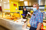 Aisling O'Connell serving Mike Baker at the deli counter in David Powers GALA shop in Abbeydorney