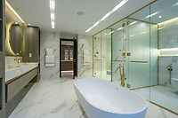 BNPS.co.uk (01202) 558833<br /> Pic: Savills/BNPS<br /> <br /> The bathroom<br /> <br /> A striking high-tech eco home that would not look out of place in a Bond film is on the market for offers over £4m.<br /> <br /> Skyfall is a luxurious house in the Berkshire countryside designed to be totally carbon free.<br /> <br /> With its luxe white interiors, minimalist decor and stunning countryside surroundings, the five-bedroom property would fit effortlessly into 007's world.<br /> <br /> But it's the eco features of the brand new house, which is just outside the village of Taplow with Huntswood Golf Course next door, that make it really stand out.