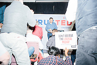 """Standing in front of a backdrop reading """"TrusTed / Courageous, Conservative, Consistent,"""" Texas senator and Republican presidential candidate Ted Cruz speaks at a town hall at Crossing Life Church in Windham, New Hampshire, on Tues. Feb. 2, 2016. The day before, Cruz won the Iowa caucus."""