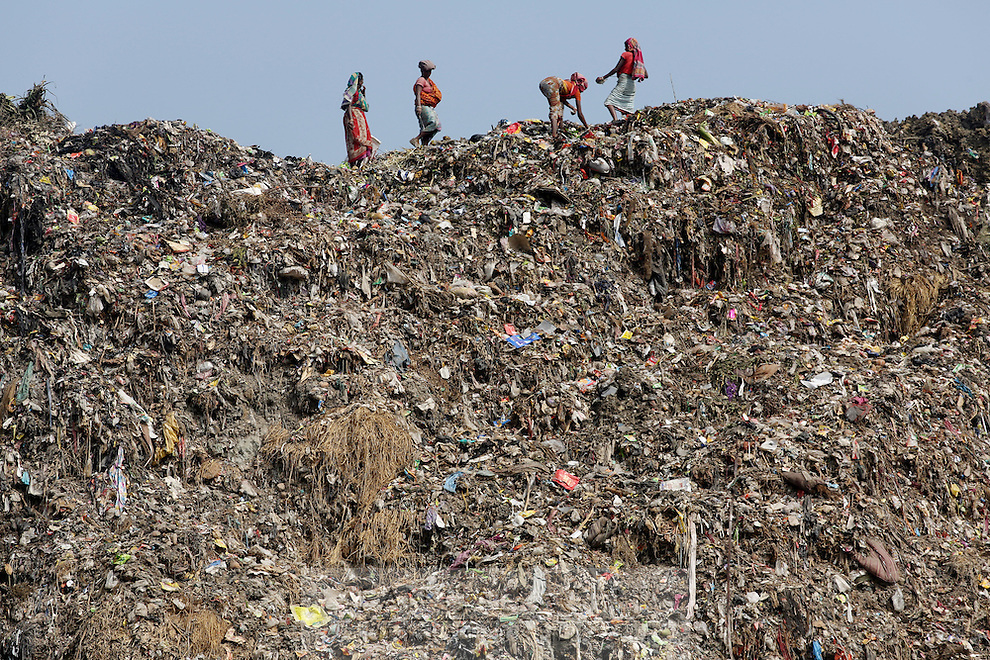 Women stand on top of the Dhapa landfill, the destination for much of Kolkata's solid waste over the past 30 years. It is estimated that only 10 percent of Kolkata's waste is recycled, contributing to the growing problem of waste that is sitting just a couple of kilometers from the city's downtown area. India. November, 2013