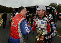 Oct. 8, 2012; Mohnton, PA, USA: NHRA runner-up driver Johnny Gray (left) congratulates funny car driver Mike Neff celebrating after winning the Auto Plus Nationals at Maple Grove Raceway. Mandatory Credit: Mark J. Rebilas-