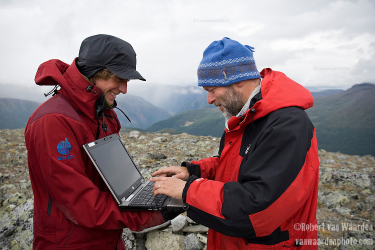 Bernd Etzelmuller, professor shares a laugh with Torbjorn Østby while setting up the computer.