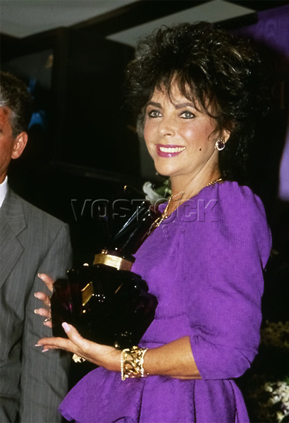 """Elizabeth Taylor Launches her Perfume """"Passion"""", 1987."""