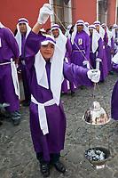 Antigua, Guatemala.  Young Boy with Incense Burner in Religious Procession during Holy Week, La Semana Santa.