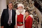 Dr. Richard Gorlick, Santa and a Lisa Hafemeister at the M.D. Anderson Santa's Elves party Thursday Dec. 07,2017. (Dave Rossman Photo)