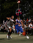 Devin Ebanks (35) drives past Corey Stokes (24) during the Elite 24 Hoops Classic game on September 1, 2006 held at Rucker Park in New York, New York.  The game brought together the top 24 high school basketball players in the country regardless of class or sneaker affiliation.