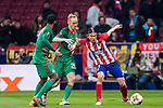 Filipe Luis (R) of Atletico de Madrid battles for the ball with Vladislav Ignatiev of FC Lokomotiv Moscow during the UEFA Europa League 2017-18 Round of 16 (1st leg) match between Atletico de Madrid and FC Lokomotiv Moscow at Wanda Metropolitano  on March 08 2018 in Madrid, Spain. Photo by Diego Souto / Power Sport Images